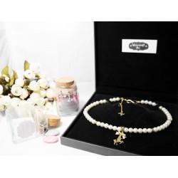"""Collier perles crème couleur doré Licorne, noeud chinois, et étoile noire """"Licorne d'Or"""""""